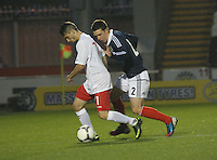 Ryan jack pressures Alessandro Alunni in the Scotland v Luxembourg UEFA Under 21 international qualifying match at St Mirren Park, Paisley on 6.9.12.