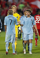 Sporting KC defender/midfielder Chance Myers #7 and Sporting KC defender Matt Besler #5 shake at the end of a MLS game between Sporting Kansas City and the Toronto FC at BMO Field in Toronto on June 4, 2011..The game ended in a 0-0 draw...