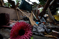 """A plastic flower lays on the ruins of a shelled house, hit by artillery in Trincomalee on the third week of September in Trincomalee, Eastern Sri Lanka on Sunday October 08 2006..A 45 old woman was in the house, after suffering major injuries she died two weeks later. her daughter and law, sitting in the compound remains up till today, shell shocked and injured to one arm..The Sri Lanka civil was is an ongoing conf, The Sri Lanka civil war is an ongoing conflict on the island nation of Sri Lanka Since the 1983 """"Black July""""  pogrom there has been on and off civil war, mostly between the government and the Liberation Tigers of Tamil Eelam, or the LTTE, who want to create an independent state of Tamil Eelam in the north east of the island. It is estimated that the war has left 65000 people dead since 1983 and caused great harm to the population and economy of the country. A cease fire was declared in 2001, but hostilities renewed in late 2005. Following escalation of violence         in July 2006, a senior rebel leader declared the ceasefire null and void, although both sides later reaffirmed their commitment to the ceasefire agreement. Hundreds of people, including military personnel, rebels, and Tamil, Sinhalese and muslim civilians have been killed in fighting this year. Thousands of civilians have been displaced, many coming from areas already stroke by the dec 2004 Tsunami.."""
