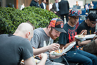 Workers eat their lunch out of styrofoam take-out containers in Midtown Manhattan in New York on Wednesday, April 10, 2013. NYC Mayor Michael Bloomberg has recently proposed a ban on styrofoam which is used in take-out containers and is difficult to recycle. Bloomberg has already targeted smoking, sugar and trans-fat in his social engineering plans. Other cities have already banned the polystyrene which is not biodegradable.  (© Richard B. Levine)