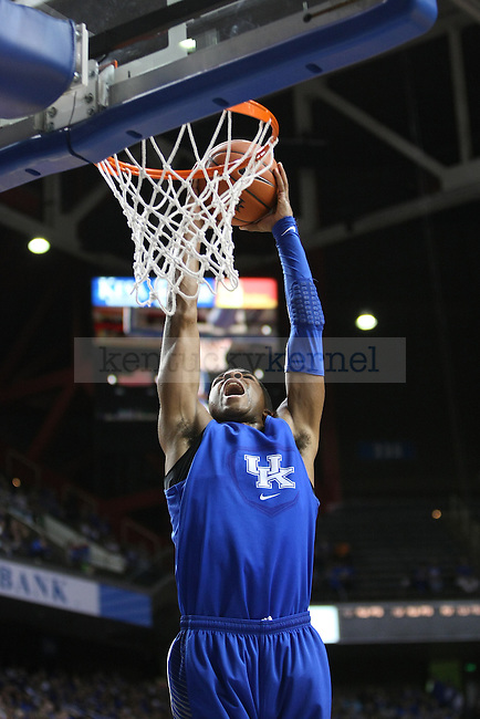 Aaron Harrison dunks the ball during the Blue and White Scrimmage in Rupp Arena in Lexington, Ky., on Monday, October 27,  2014. Photo by Emily Wuetcher | Staff