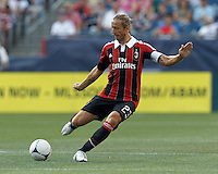 AC Milan substitute midfielder Massimo Ambrosini (23) passes the ball. In an international friendly, AC Milan defeated C.D. Olimpia, 3-1, at Gillette Stadium on August 4, 2012.