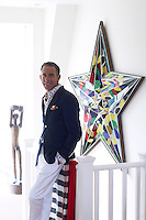 """Ben de Lisi stands on the landing of his London town house beside a """"one-off"""" 1950s star from Jean Brown"""