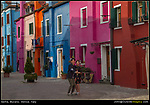 Italy, Venice.  <br /> Someone with a good eye might determine when a photo was taken by its photographic style or a certain fashion. We are now in the smart phone and selfie era. How long will it last?  Tourists being seen in Burano, Venice, Italy.