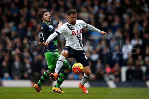 28.02.2016. White Hart Lane, London, England. Barclays Premier League. Kyle Walker of Tottenham Hotspur and Alberto Paloschi of Swansea battle for the ball during the Barclays Premier League match between Tottenham Hotspur and Swansea City.