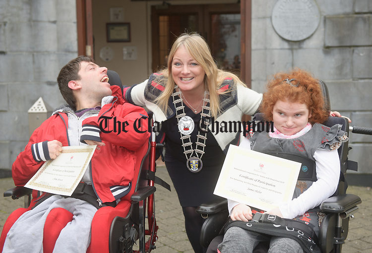 Councillor Mary Howard presents Chime Brown of Glendree Feakle and Teresa Davoren from Lahinch with their certificates of participation for the Phoenix Sister Cities International Competition For Artists With Disabilities 2015 at a ceremony in the Temple Gate hotel Ennis. Photograph by John Kelly.