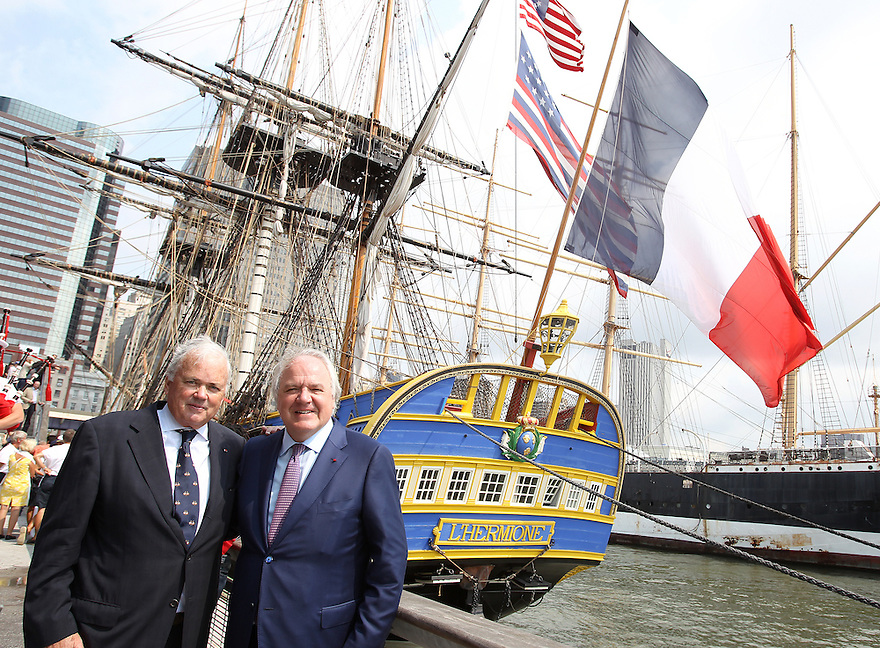 "Craig Stapelton former US Ambassador for France and Christophe Navarre President and CEO of Moet Hennessy poses for a photo while the Hermione is seen behind them docked at the ""Hennessy 250  Celebrates the Hermione's arrival in New York Harbor"" at Pier 15 on Wednesday, July 1, 2015, in New York. (Photo by Donald Traill/Invision for Moet Hennessy/AP Images"