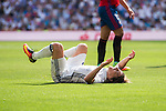 Luka Modric of Real Madrid lied on the ground in pain during the La Liga match between Real Madrid and Osasuna at the Santiago Bernabeu Stadium on 10 September 2016 in Madrid, Spain. Photo by Diego Gonzalez Souto / Power Sport Images