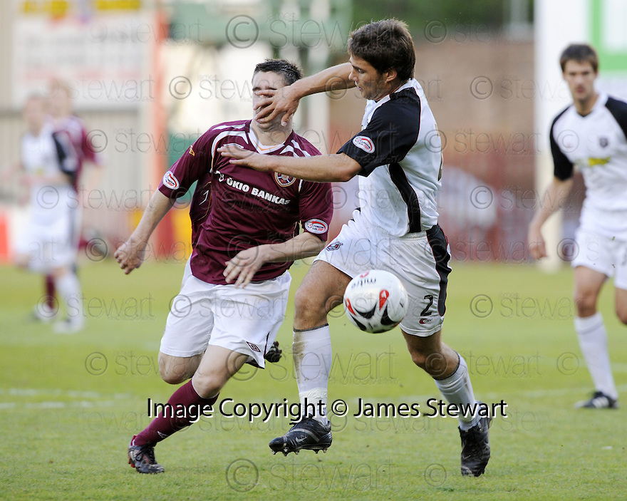 13/05/2008   Copyright Pic: James Stewart.File Name : sct_jspa04_gretna_v_hearts.GARY GLEN IS PUSHED OFF THE BALL BY CRAIG BARR.James Stewart Photo Agency 19 Carronlea Drive, Falkirk. FK2 8DN      Vat Reg No. 607 6932 25.Studio      : +44 (0)1324 611191 .Mobile      : +44 (0)7721 416997.E-mail  :  jim@jspa.co.uk.If you require further information then contact Jim Stewart on any of the numbers above........