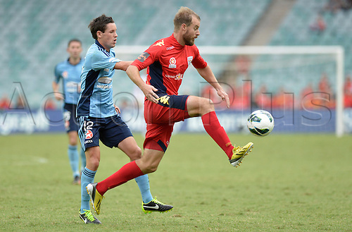 16.02.2013 Sydney, Australia. Adelaide defender Iain Fyfe and Sydney forward Blake Powell in action during the Hyundai A League game between Sydney FC and Adelaide United from the Allianz Stadium.