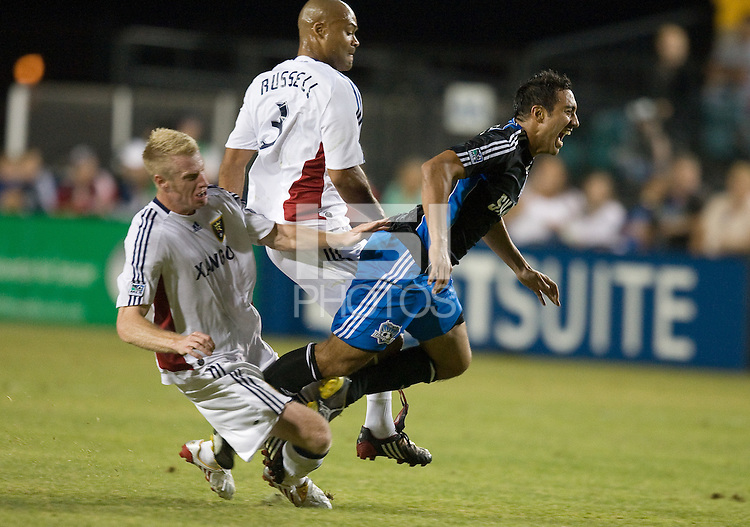 Nate Borchers, left, tackles Arturo Alavarez from behind during a 3-2 victory by Real Salt Lake in Santa Clara, California, Sept., 27, 2008. Photo by John Todd/isiphotos.com