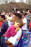 Father carrying thumb sucking daughter  at Cinco de Mayo age 24 and 3.  St Paul Minnesota USA