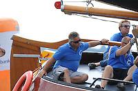 SKUTSJESILEN: SNEEK: Snitser Mar, 10-08-2012, SKS skûtsjesilen, wedstrijd Sneek, Doarp Grou, skûtsje Grou, met een 3e plaats tijdens de laatste wedstrijd klimt Douwe Azn. Visser naar de 2e plek in het eindklassement, Tammo Oosterhof (adviseur), Douwe Tzn. Visser (schotenman), ©foto Martin de Jong