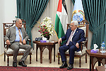 Palestinian President Mahmoud Abbas meets with Chairman of the Board of Trustees of al-Azhar University, Ibrahim Brash, at Abbas's headquarter in the West Bank city of Ramallah, May 18, 2019. Photo by Thaer Ganaim