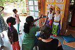 Children play about Shiva's life legends in an Auroville school. 2014