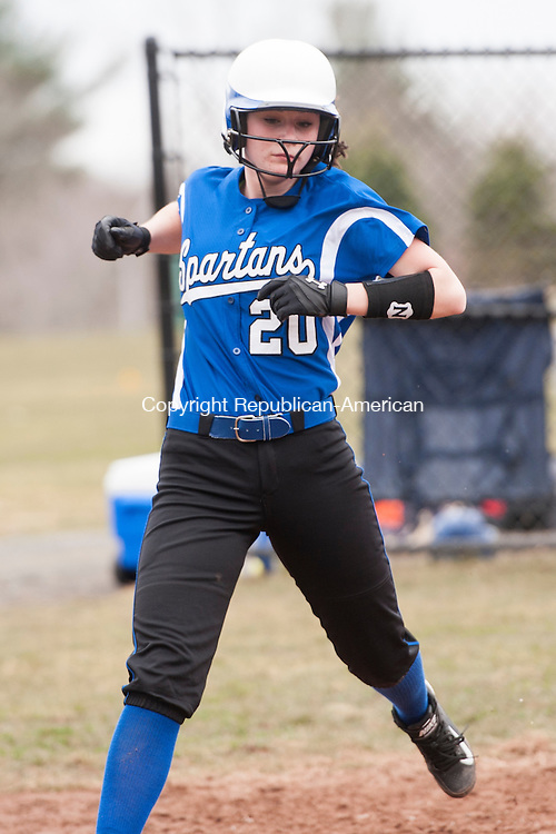 LITCHFIELD, CT-14 April 2015-041415EC08-  Action man. Lewis Mills' Emma Kryzanski hops onto home base and scores against Litchfield Tuesday. Erin Covey Republican-American