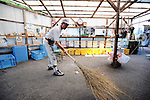 Masaru Goto, 73, sweeps up as part of his daily chores at the waste disposal site in central Kamikatsu Town in Shikoku, Japan. The town, whose residents number just over 2,000 people, has implemented a waste recycling policy that aims at eliminating waste entirely within the next 12 years and employs retired local residents to care for the waste disposal center.