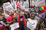 """© Joel Goodman - 07973 332324 . 10/08/2013 . London , UK . STEPHEN FRY at the demonstration . Protesters with placards . Demonstration against homophobic laws being enacted in Russia on Whitehall this afternoon (10th August 2013) . Legislation includes banning gay pride events for100 years , banning the distribution of """" propaganda of non-traditional sexual relations """" to minors , making it illegal for the adoption of Russian children by gay couples or any single person who comes from a country that recognises marriage equality and giving authorities the rights to arrest foreign nationals whom they suspect are LGBT or pro gay with the right to detain them for up to 14 days. Photo credit : Joel Goodman"""