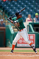 Greensboro Grasshoppers shortstop Marcos Rivera (11) at bat during a game against the Lakewood BlueClaws on June 10, 2018 at First National Bank Field in Greensboro, North Carolina.  Lakewood defeated Greensboro 2-0.  (Mike Janes/Four Seam Images)