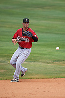 Birmingham Barons second baseman Joey DeMichele (27) fields a ground ball during a game against the Biloxi Shuckers on May 24, 2015 at Joe Davis Stadium in Huntsville, Alabama.  Birmingham defeated Biloxi 6-4 as the Shuckers are playing all games on the road, or neutral sites like their former home in Huntsville, until the teams new stadium is completed.  (Mike Janes/Four Seam Images)