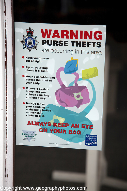 Sign warning purse thefts