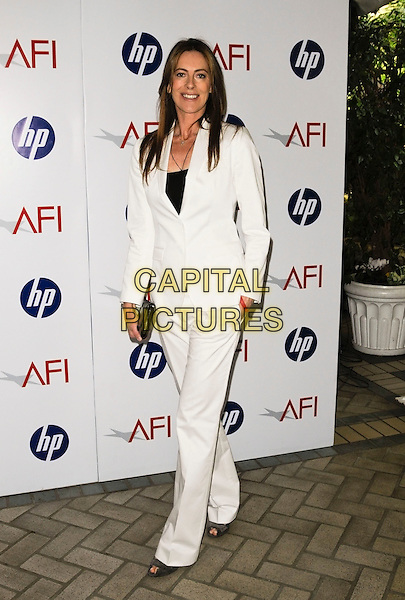 KATHRYN BIGELOW .At the 10th Annual AFI Awards at the Four Seasons Hotel in Los Angeles, California, USA, January 15th, 2010..arrivals Full length white trousers trouser suit jacket clutch bag black .CAP/ROT.©Lee Roth/Capital Pictures.