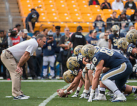 Pitt head coach Pat Narduzzi gets an upclose look at his field goal team before the game. The Miami Hurricanes football team defeated the Pitt Panthers 29-24 on  Friday, November 27, 2015 at Heinz Field, Pittsburgh, Pennsylvania.