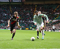 Georgios Samaras being chased by David van Zanten in the Celtic v St Mirren Clydesdale Bank Scottish Premier League match played at Celtic Park, Glasgow on 15.12.12.