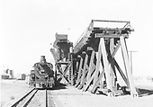 D&amp;RGW #495 loading coal at Antonito coaling trestle.  Head-on view of #495, end view of trestle.<br /> D&amp;RGW  Antonito, CO  Taken by Gibson, William A. Sr. - 8/30/1956