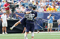 Goalkeeper Jack Starr  (#23) celebrates the win with Ryan McQuaide  (#22) as Yale defeats UAlbany 20-11 in the NCAAA semifinal game at Gillette Stadium, May 26.
