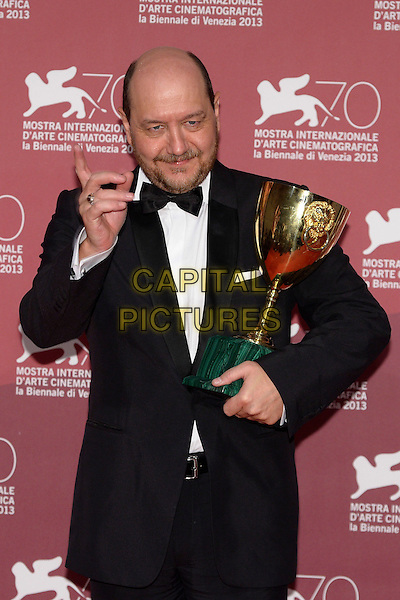 Themis Panou <br /> at the Award Winners Photocall during the 70th Venice International Film Festival, Palazzo del Casino in Venice, Italy, September 7th 2013.<br /> half length black suit tux tuxedo bow tie trophy award winner trophy<br /> CAP/ZZG<br /> &copy;ZZG/Capital Pictures