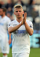 Stephen Kingsley of Swansea City applauds home supporters after the Premier League match between Swansea City and Watford at The Liberty Stadium on October 22, 2016 in Swansea, Wales, UK.