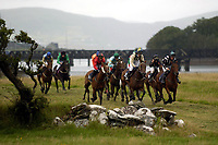 Eventual winner Inspector Morse (green cap in centre) riden by Kevin Coleman makes headway through the field to win the Derby at  Cahirciveen races in County Kerry on Sunday evening.<br />