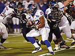 Boise State Broncos running back Doug Martin makes his way through the Nevada defensein the first quarter against of their game in Reno.(AP Photo/Cathleen Allison)