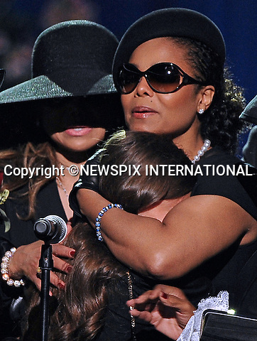 "JANET JACKSON - Is she the new stepmom?.It was very much in evidence how aunt Janet Jackson took control of the situation when Paris Jackson, Michael daughter broke down in tears while paying a tribute to her father..Her maternal instinct appeared to go into action, with a big hug for the little girl. Prince Michael l too cuddled up to her. .During the memorial Janet cuddled both Paris and Prince Michael ll..With the their grandmother considered too old at 79-years-old to be their guardian, the coming weeks will tell whether Janet has indeed stepped in..Michael Jackson Memorial, Staples Center, Los Angeles_07/07/2009.Mandatory Photo Credit: ©MJP/Newspix International..**ALL FEES PAYABLE TO: ""NEWSPIX INTERNATIONAL""**..PHOTO CREDIT MANDATORY!!: NEWSPIX INTERNATIONAL(Failure to credit will incur a surcharge of 100% of reproduction fees)..IMMEDIATE CONFIRMATION OF USAGE REQUIRED:.Newspix International, 31 Chinnery Hill, Bishop's Stortford, ENGLAND CM23 3PS.Tel:+441279 324672  ; Fax: +441279656877.Mobile:  0777568 1153.e-mail: info@newspixinternational.co.uk"