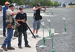 Coaches Greg and Rusty Wolbers work with Robert Lamkin and Weston Swift, both 13, during practice at the Capital City Gun Club, in Carson City, Nev., on Friday, July 11, 2014.<br />