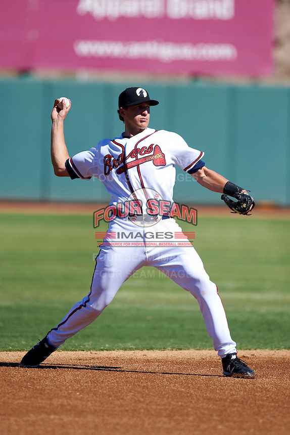 Phoenix Desert Dogs shortstop Nick Ahmed #12, of the Atlanta Braves organization, during an Arizona Fall League game against the Mesa Solar Sox at Phoenix Municipal Stadium on October 19, 2012 in Phoenix, Arizona.  Phoenix defeated Mesa 10-6.  (Mike Janes/Four Seam Images)