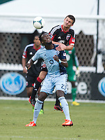 Kei Kamara (23) of Sporting Kansas City fights for a header with Perry Kitchen (23) of D.C. United during a Major League Soccer match at RFK Stadium in Washington, DC.  D.C. United tied Sporting Kansas City, 1-1.