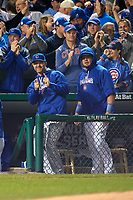 Chicago Cubs David Ross (left) gestures as Kyle Schwarber looks on in the first inning during Game 4 of the Major League Baseball World Series against the Cleveland Indians on October 29, 2016 at Wrigley Field in Chicago, Illinois.  (Mike Janes/Four Seam Images)