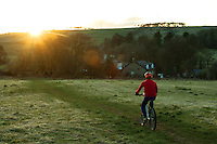 A cyclist cycling in Neilston, East Renfrewshire