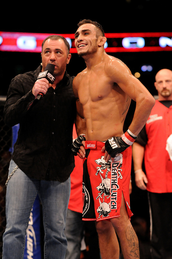 24 SEPTEMBER 2011:   Tony Ferguson celebrates his win over Aaron Riley as he talks to Joe Rogan during UFC 135 at the Pepsi Center in Denver, Colorado. *****For Editorial Use Only*****