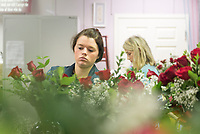 Julia Putt, a recent MSU horticulture graduate from Flowood, and Sarah Rhett, a senior marketing major from Meridian, make Valentine's Day bouquets at the Mississippi State University Florist. For last-minute Valentine's Day shoppers, the florist will be open until 4 p.m. Wednesday [Feb. 14] and has special bouquets available.<br />