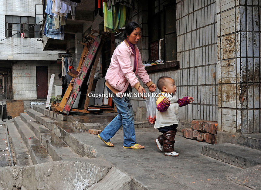 A mother looks after her daughter closely in Ri Xin Village in Kunming. Kunming is one of China's hot-spots for child abductions in China.