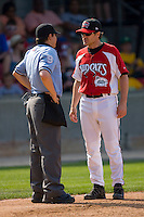 Carolina Mudcats manager David Bell #25 discusses a call with home plate umpire Gerard Ascani during a Southern League game against the Jacksonville Suns at Five County Stadium May 16, 2010, in Zebulon, North Carolina.  Photo by Brian Westerholt /  Seam Images