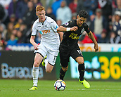 10th September 2017, Liberty Stadium, Swansea, Wales; EPL Premier League football, Swansea versus Newcastle United; Sam Clucas of Swansea City and Ayoze Perez of Newcastle United battle for possession during the match