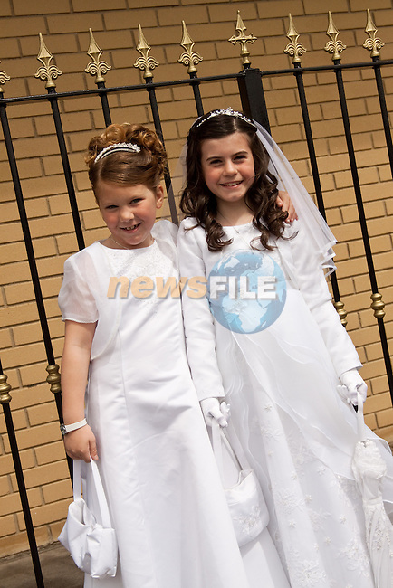 Kacey Thornton and Chloe Doyle at St. John's First Communion in Holy Family Church, Ballsgrove on Sunday.Picture: Newsfile/Mark Carroll