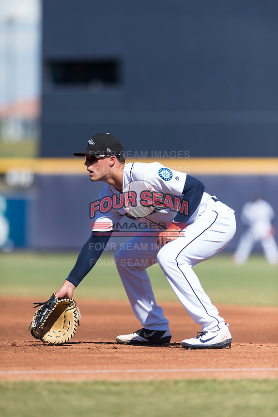 Peoria Javelinas first baseman Evan White (15), of the Seattle Mariners organization, during an Arizona Fall League game against the Glendale Desert Dogs at Peoria Sports Complex on October 22, 2018 in Peoria, Arizona. Glendale defeated Peoria 6-2. (Zachary Lucy/Four Seam Images)