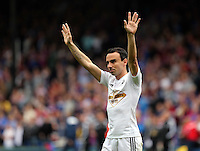 Pictured: Leon Britton of Swansea thanks away supporters<br />
