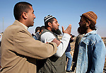 A Palestinian man scuffles with Jewish settlers as he try to evacuate them from Palestinian land near the village of Yatta, south of the West Bank city of Hebron on Jan. 2, 2011. Photo by Najeh Hashlamoun