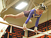 Kerin Spadaro of Bay Shore-Islip performs on the uneven bars during the Suffolk County varsity girls' gymnastics individual championships at Babylon High School on Friday, November 6, 2015.<br /> <br /> James Escher